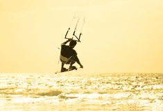 Kitesurfer jumping Stock Photos