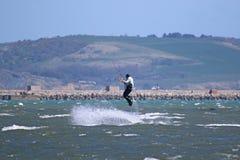 Kitesurfer jumping Stock Photo