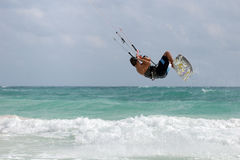 Kitesurfer jumping wave. In idyllic caribbean sea Royalty Free Stock Image