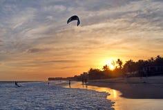 Kitesurfer kiteboarder kitesurfing kiteboarding at sunset Royalty Free Stock Photo