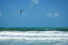 A kitesurfer kiteboarding at ocean Stock Image