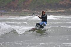 Kitesurfer. Riding his board in waves Stock Photo