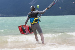 Kitesurfer launches his kite in the lake of Santa Croce Royalty Free Stock Photo