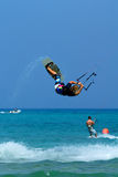 Kitesurfer making extreme trick Royalty Free Stock Image