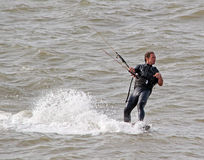 Kitesurfer one handed stunts Royalty Free Stock Photos