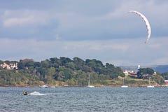 Kitesurfer in Portland harbour. Kitesurfer riding in Portland Harbour Royalty Free Stock Photo