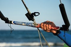 Kitesurfer ready for kitesurfing rides in blue sea Stock Image