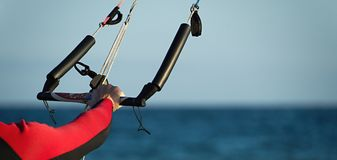 Kitesurfer ready for kitesurfing rides in blue sea Royalty Free Stock Photo