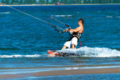 Free Kitesurfer Rides On The Surfboard And Enjoys The Sea Royalty Free Stock Photography - 53011527