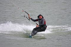 Kitesurfer riding board stock photos