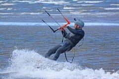 Kitesurfer. Riding in flat water Royalty Free Stock Photo