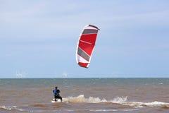 Kitesurfer riding Stock Images
