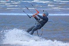 Kitesurfer. Riding on his board Stock Image