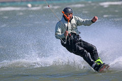 Kitesurfer. Riding on his board Royalty Free Stock Images