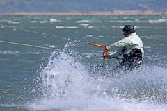 Kitesurfer riding his board Royalty Free Stock Photography