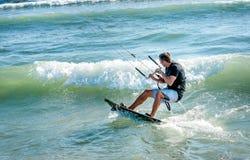 Kitesurfer riding on Kiteboard on the beach in Ulcinj, Montenegr. O Stock Image