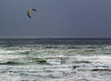 Kitesurfer in rough sea. Scenic view of single kitesurfer in rough sea or ocean Stock Photo
