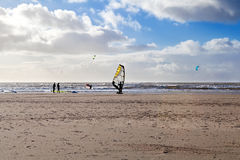 Kitesurfer on sand beach at North sea Stock Images