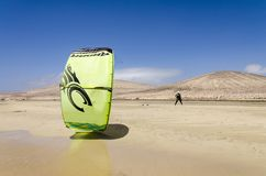 Kitesurfer on Sotavento beach on Fuerteventura. Sotavento beach, Fuerteventura, Canary Islands, Spain: May 15th 2018. A kitesurfer training in Rene Egli stock photo