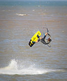 Kitesurfer stuntman. Photo of a kitesurfer performing stunts off the coast of whitstable in kent on 3rd september 2014.photo ideal for water sports,surfing Royalty Free Stock Images
