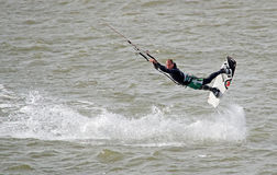 Kitesurfer stunts Stock Photography