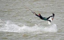 Kitesurfer stunts Stock Photography