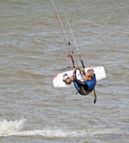 Kitesurfer stunts Stock Photos