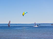 Kitesurfer swimming in sea. Royalty Free Stock Photos