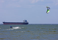 Kitesurfer and Tanker Royalty Free Stock Photo
