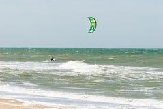 Kitesurfer in waves. Kitesurfer kitting on the North Sea at high speed near the beach Stock Photo