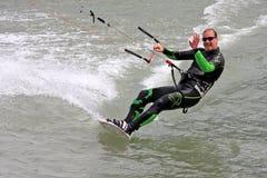 Kitesurfer riding his board stock photos
