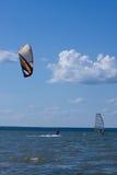 Kitesurfer and windsurfer in action. Kitesurfer and windsurfer in  action Royalty Free Stock Photo