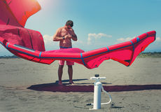 Kitesurfers on the beach prepare sport equipment. For riding Royalty Free Stock Images