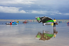 Kitesurfers on a beach