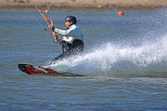 Kitesurfers carving his board Royalty Free Stock Images