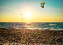 kitesurfers and sunset flare Royalty Free Stock Images