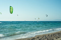 Kitesurfers on Milos beach Stock Photography