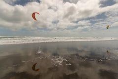Kitesurfers on Muriwai beach Royalty Free Stock Images