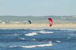 Kitesurfers off Gamboa beach in Peniche Portugal Stock Photos