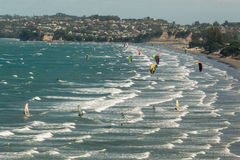 Kitesurfers in Omaha Bay in New Zealand. Aerial view of kitesurfers in Omaha Bay in New Zealand stock image