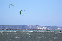 Kitesurfers in Portland Harbour Royalty Free Stock Images