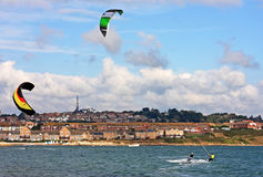 Kitesurfers in Portland harbour Royalty Free Stock Photography