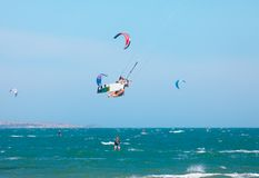 Kitesurfers riding the waves Stock Photography