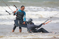 Kitesurfers in the waves Stock Photo