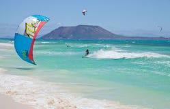 Kitesurfing. Fuerteventura,Spain - June,  2012: Practicing   kitesurfing (kiteboarding) at the Corralejo Flag Beach on Fuerteventura, Canary Islands. Strong Stock Photo