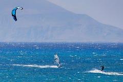Kitesurfing in Agrillaopotamos of Karpathos, Greece. Kitesurfing and windsurfing in Agrillaopotamos of Karpathos, Greece Stock Photography
