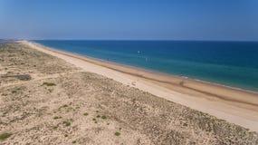 Kitesurfing amateur athletes on the beaches of Cabanas Tavira. stock photo