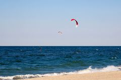 Kitesurfing background concept, two kitesurfers at the sea ocean Stock Image