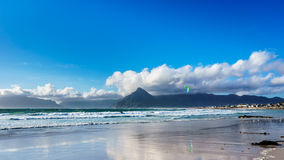 Kitesurfing at the beach community of Het Kommitjie near Cape Town Royalty Free Stock Image