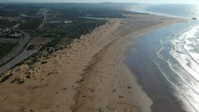 Kitesurfing at the Beach in Essaouira near Marrakesh in Morocco by Drone from above stock video